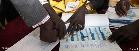 Fingerprint being made on a ballot paper