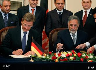 Afghan Foreign Minister Zalmai Rasoul, right, with German counterpart Guido Westerwelle