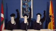 In this image made from video, masked members of the militant Basque separatist group ETA raise their fists as they declare a permanent cease-fire in a video distributed to Spanish media Monday, Jan. 10, 2011, in what it called a firm step toward ending its bloody decades-long independence fight, but Spain's government quickly dismissed the announcement and demanded ETA disband outright. (Foto:Associated Press Television Network/AP/dapd)