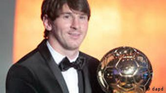 Lionel Messi holds the cup after he was awarded with the FIFA Ballon d'Or, footballer of the year 2010, during a ceremony in Zurich