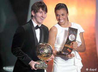 Lionel Messi and Marta with their trophies