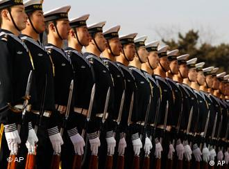 Members of the Chinese Navy's honor guard wait for U.S. Secretary of Defense Robert Gates to review military troops at an arrival ceremony at Bayi Building in Beijing, China, Monday, Jan. 10, 2011. (AP Photo/Larry Downing, Pool)