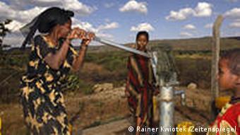 Ethiopian women fetch water from a borehole.