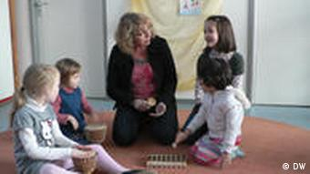 Director Holland drumming with kids in pre-school