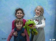 Kids holding stuffed frog