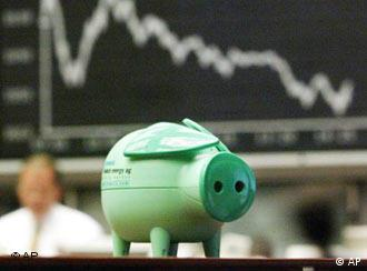 A small piggy bank is seen in the Frankfurt stock exchange