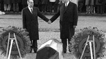 Former French President Francois Mitterand and former German Chancellor Helmut Kohl commemorate World War I at Verdun in 1984
