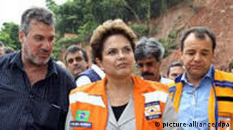 Brazilian President, Dilma Rousseff (C), along with Rio de Janeiro state Governor, Sergio Cabral (R), in Nova Friburgo, Rio de Janeiro state, Brazil, on 13 January 2010.
