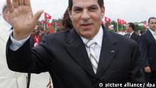 epa02529511 (FILE) A file photograph dated 11 October 2009, shows the then Tunisian President Zine El Abidine Ben Ali waving to wellwishers at the start of the presidential election campaign at Rades stadium, near Tunis, Tunisia. According to media reports on 14 January 2011, Tunisia's President Ben Ali has stepped down 14 January evening amid demonstrations in the capital Tunis and other cities of the country. Tunisian Prime Minister Mohammed Ghannouchi said on Tunisian television on 14 January evening that he will be taking over from President Ben Ali. A state of emergency has been declared, and Tunisian air space has been closed amid protests against unemployment, rising prices and corruption. EPA/STR +++(c) dpa - Bildfunk+++