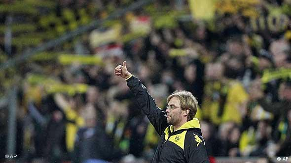 Dortmund head coach Juergen Klopp reacts during the German first division Bundesliga soccer match between .Bayer 04 Leverkusen and BvB Borussia Dortmund in Leverkusen, Germany, Friday, Jan. 14, 2011. (AP Photo/Frank Augstein) ** NO MOBILE USE UNTIL 2 HOURS AFTER THE MATCH, WEBSITE USERS ARE OBLIGED TO COMPLY WITH DFL-RESTRICTIONS, SEE INSTRUCTIONS FOR DETAILS **