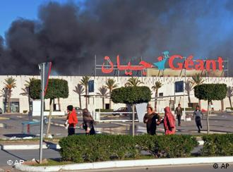People run from a burning supermarket
