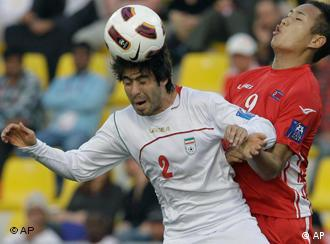 No goal: North Korea's Jong Tae Se (right) was unable to score during the Asian Cup