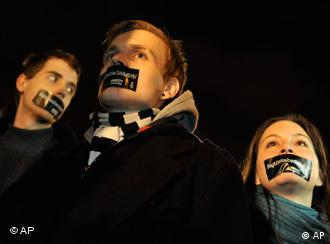 Hungarian Amnesty International activists protest with taped mouth