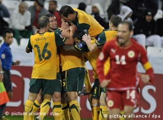 Australian players celebrate after scoring the opening goal against Bahrain