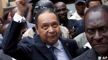 ALTERNTIVE CROP OF XRE114 - Haiti's ex-dictator Jean-Claude Duvalier gestures to supporters as police take him out of his hotel in Port-au-Prince, Haiti, Tuesday Jan. 18, 2011. Haitian police took Duvalier, who abruptly returned to Haiti on Sunday, out of his hotel to a waiting SUV without saying whether he was being detained for crimes committed under his brutal regime. (AP Photo/Ramon Espinosa)