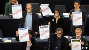 European lawmakers holding posters at the European Parliament in Strasbourg during a visit by PM Viktor Orban (unseen)