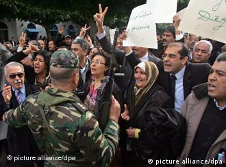 Protestors shout slogans against former Tunisian President Zine El Abidine Ben Ali