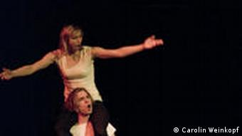 A woman singing on a man's shoulders