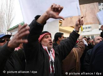 protesters shout in front of the Jordanian Parliament in the capital Amman