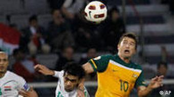 Harry Kewell (r) fights for the ball with Iraq's Ali Erhaima during their Asian Cup quarterfinal