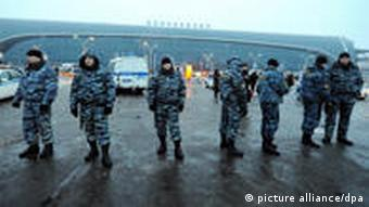 Security personnel outside a terminal at Domodedovo Airport