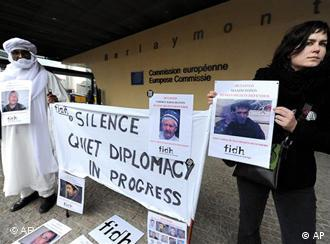 A protestor holds a picture of a detained Uzbek human rights defender during a demonstration outside the EU Commission headquarters in Brussels, Monday, Jan. 24, 2011. (AP Photo/Geert Vanden Wijngaert)