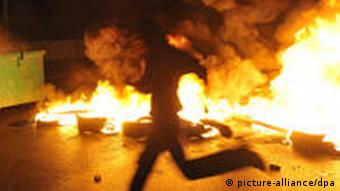 Followers of Lebanon's caretaker prime minister Saad Hariri burn tires during a rally in Beirut
