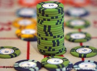 A large pile of roulette chips chips surrounded by smaller bets