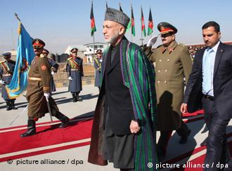 Afghan President Hamid Karzai arrives to open the new parliament in Kabul