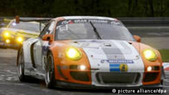 A Porsche GT3R Hybrid racing on the Nordschleife.