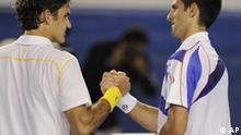 Switzerland's Roger Federer, is congratulated by Serbia's Novak Djokovic aftre winning their semifinal at the Australian Open tennis championships in Melbourne, Australia, Thursday, Jan. 27, 2011. (AP Photo/Andrew Brownbill)