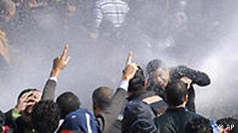Protesters in Cairo are hit with water cannons fired by riot police