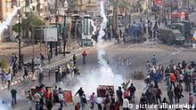 epa02552382 Egyptian protesters clash with riot police during a protest in Suez, Egypt, 27 January 2011. According to the media reports, death toll reached six during fresh protests that broke out 26 January, as protesters were calling for the dissolution of parliament, implementation of democracy and higher wages, along with the ouster of Egyptian President Hosni Mubarak. Suez protesters, who were demanding compensation and an investigation into the killings among protesters, set ablaze the police station and town hall during protest in the city 26 January. EPA/STR