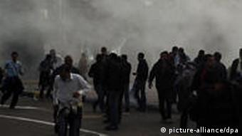Egyptian anti-riot police use tear gas to disperse protesters