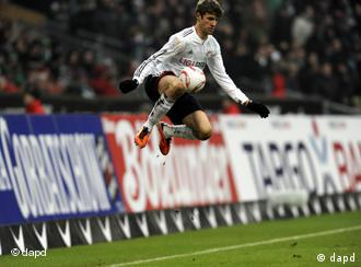 Bayern's Thomas Müller jumps in the air