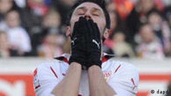 Stuttgart player covers his face