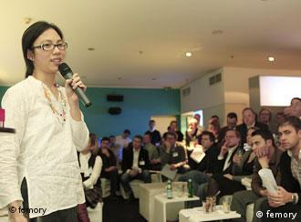 An entrepreneur makes her pitch to the audience