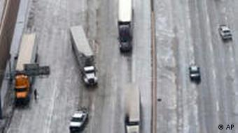 An aerial view looking south shows traffic on an icy Interstate 35E on Tuesday, Feb. 1, 2011, near Dallas. Five days before the Super Bowl, a wintry blast of snow, ice and bone-chilling winds hit the Dallas area on Tuesday, closing the airport for a couple of hours and turning roads into ice rinks. (AP Photo/The Dallas Morning News, David Woo) ** MAGS OUT TV OUT MANDATORY CREDIT INTERNET: AP MEMBERS ONLY **