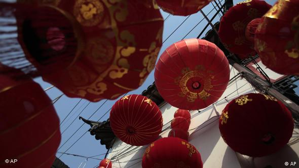 Crimson lanterns are hung for the Chinese new year celebrations