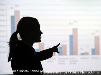 Woman in silhouette in front of charts