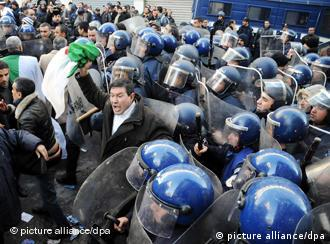 Police and protesters in Algeria