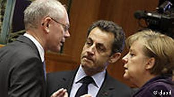 Hermann van Rompuy, Nicolas Sarkozy and Angela Merkel in animated discussion