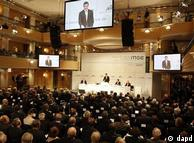 German Defense Minister Karl-Theodor zu Guttenberg, center, addressing delegates at the Munich Security Conference