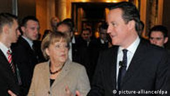 German Chancellor Angela Merkel (l) gestures besides British Prime Minister David Cameron