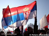 Supporters of Serbia's opposition party wave national flags during a major anti-government rally in Belgrade