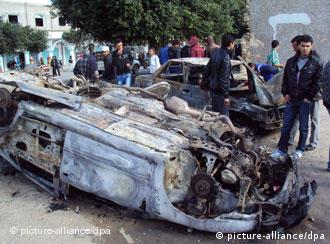 A burnt out, overturned car at the site of the Sidi Bouzid demonstration