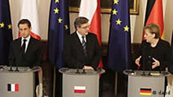Sarkozy (left), Komorowski and Merkel