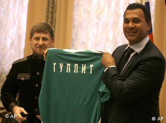 Dutch soccer coach Ruud Gullit, right, shows a shirt reading Gullit in Cyrillic, as he meets with Chechen leader Ramzan Kadyrov