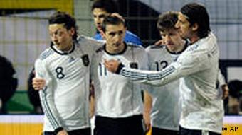 Germany's Miroslav Klose and teammates