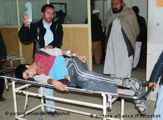 A victim of the attack is transported to receive medical treatment in a hospital in Mardan